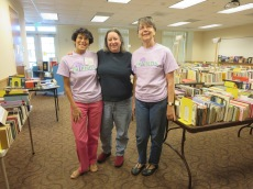 Board member Lori-Ann Shapiro, Book Sale Coordinator Stacey Gamble, and volunteer Debbie Simmers.